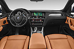 Stock photo of straight dashboard view of a 2015 BMW X4 M sportpakket 5 Door SUV 2WD Dashboard