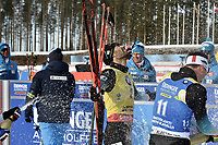 March 14th 2020, Kontiolahti, Finland;   Martin Fourcade C of France is sprayed with champagne as he celebrates victory and end of career after the mens 12.5 km Pursuit competition at the IBU Biathlon World Cup in Kontiolahti, Finland, on March 14, 2020. Fourcade ends his career now at the end of the season in Kontiolahti where he took his first World Cup victory exactly 10 years ago on March 14, 2010.