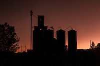Silhouette of a grain elevator in Steptoe Washington in the Palouse region at sunset.