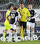 Scott Arfield scaraps with team-mate Robert Olejnik