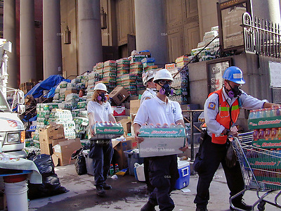 Food and water are piled on the steps of St.Peters where trinity cemetery is and volunteers carry supplies in tto trinity church Friday  Sept.15,2001.