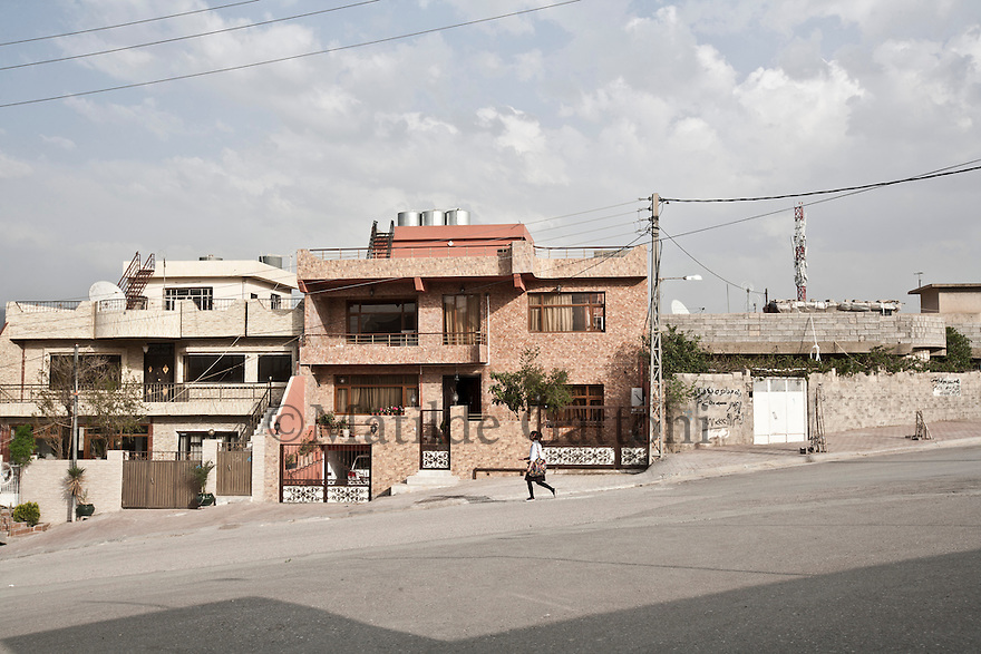 Iraq - Kurdistan - Sulaymaniyah -  A woman walking by in a residential area