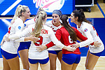 PENSACOLA, FL - DECEMBER 09: Bethany Besancenez (10) of Florida Southern College, center, speaks with teammates in between serves during the Division II Women's Volleyball Championship held at UWF Field House on December 9, 2017 in Pensacola, Florida. (Photo by Timothy Nwachukwu/NCAA Photos via Getty Images)