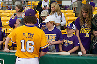 LSU Tigers pitcher Jared Poche (16) signs autographs before the Southeastern Conference baseball game against the Texas A&M Aggies on April 25, 2015 at Alex Box Stadium in Baton Rouge, Louisiana. Texas A&M defeated LSU 6-2. (Andrew Woolley/Four Seam Images)