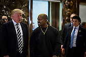 United States President-elect Donald J. Trump and Musician Kanye West pose for photographers in the lobby of Trump Tower in Manhattan, New York, U.S., on Tuesday, December 13, 2016. <br /> Credit: John Taggart / Pool via CNP