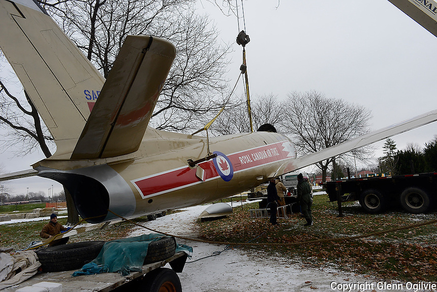 Volunteers and members the Canadian Owner Pilots Association Flight 7, Sarnia were at Germain Park to remount a vintage F86 Sabre fighter jet used by the Golden Hawks flying team, back on its pedestal.