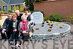 HONOUR: Pictured at the plaque in honour of former president Mary McAleese's visit to Iveragh Park/Cloverhill Close in May 2011 were front l-r: Mary O'Sullivan (vice chair of IP/CC residents association) and Esther Moriarty. Back l-r: Adrian O'Connor, John Sheehan (chairman of IP/CC residents association) and Tracy Cronin.