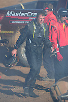 Apr 16, 2011; Surprise, AZ USA; LOORRS driver Corey Sisler climbs from his burning truck after a fire during round 3 at Speedworld Off Road Park. Mandatory Credit: Mark J. Rebilas-.