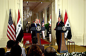 Washington, D.C. - June 24, 2005 -- United States President George W. Bush and Prime Minister Ibrahim al-Jaafari of Iraq hold a joint press conference in the East Room at the White House in Washington, D.C. on June 24, 2005.  They discussed the re-building of Iraq and refused to give a time-table for the withdrawal of United States forces.<br /> Credit: Ron Sachs / CNP