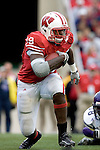 MADISON, WI - SEPTEMBER 9: Running back P.J. Hill #39 of the Wisconsin Badgers carries the ball against the Western Illinois Leathernecks at Camp Randall Stadium on September 9, 2006 in Madison, Wisconsin. The Badgers beat the Leathernecks 34-10. (Photo by David Stluka)
