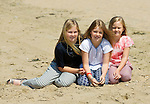 Princesses Amalia, Alexia and Ariane  of the Netherlands pose for photographers during a photo session on the beach near Wassenaar, the Netherlands, July 10, 2015. © Michael Kooren