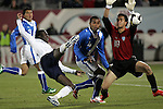 19 November 2008: Jozy Altidore (Villarreal)(left) of the USA takes a shot, as Ricardo Jerez (Renitistas)(18) of Guatemala closes down the play.  The United States Men's National Team defeated the visiting Guatemala Men's National Team 2-0 at Dick's Sporting Goods Park in Commerce City, Colorado in a CONCACAF semifinal round FIFA 2010 South Africa World Cup Qualifier.