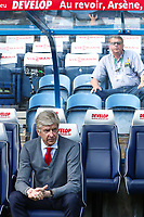 Arsenal manager Arsene Wenger before his final game as manager the bench above him reads Au revoir, Arsene, et merci during the Premier League match between Huddersfield Town and Arsenal at the John Smith's Stadium, Huddersfield, England on 13 May 2018. Photo by Thomas Gadd / PRiME Media Images.