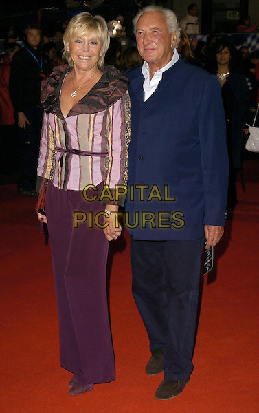 "MICHAEL WINNER & GUEST.""The Prestige"" UK film premiere.Odeon West End cinema, Leicester Square.5th November 2006 London, England.Ref: CAN.full length.www.capitalpictures.com.sales@capitalpictures.com.©Phil Loftus/Capital Pictures"