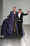 """Fashion designer Zang Toi walks runway with model for the close of his Zang Toi Fall 2017 """"Brilliant Royal Blue"""" collection fashion show, at Pier59 Studios on February 13, 2017; during NYFW: The Shows Fall Winter 2017."""