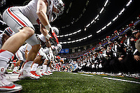 The Ohio State Buckeyes do the quick cals drill with the Ohio State Marching Band and  fans before the Allstate Sugar Bowl and College Football Playoff Semifinal at Mercedes-Benz Superdome in New Orleans, Thursday night, January 1, 2015. The Ohio State Buckeyes defeated the Alabama Crimson Tide 42 - 35 to move on to the National Championship. (The Columbus Dispatch / Eamon Queeney)