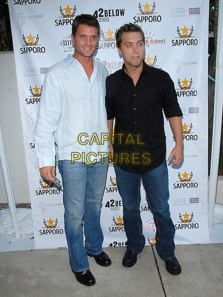 "REICHEN LEMKUHL & LANCE BASS.attend The Launch of Jaime Pressly and Hill Harper's ""Adopt-a-School Initiave"" held at RJ Cutler's Estate in The Hollywood Hills, California, USA, August 12, 2006..full length black shirt jeans.Ref: DVS.www.capitalpictures.com.sales@capitalpictures.com.©Debbie VanStory/Capital Pictures"