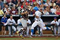 UCLA outfielder Brian Carroll (24) sprints home in the first inning before Mississippi State catcher Nick Ammirati (17) can tag him in the 2013 Men's College World Series Final on June 25, 2013 at TD Ameritrade Park in Omaha, Nebraska. The Bruins defeated the Bulldogs 8-0, winning the National Championship. (Andrew Woolley/Four Seam Images)
