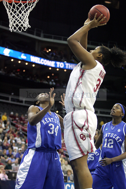 Oklahoma senior center Abi Olajuwon shoots during the first half of their game against UK on Tuesday, March 30, 2010 during the Kansas City Regional Final at the Sprint Center in Kansas City, Mo. The Sooners defeated the Cats, 88-68. Photo by Allie Garza | Staff