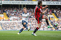 Christian Eriksen of Tottenham Hotspur shoots under pressure from Harry Arter of Bournemouth during the Premier League match between Tottenham Hotspur and Bournemouth at White Hart Lane, London, England on 15 April 2017. Photo by Mark  Hawkins / PRiME Media Images.