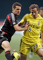 7 May 2005. Ben Olsen (14) of DC United collides with Domenic Mediate (28) of Columbus  at RFK Stadium in Washington, DC.