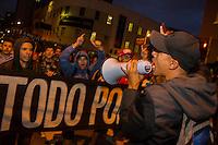 CURITIBA, PR, 18.02.2014 PROTESTO / NÃO VAI TER COPA  -  Foi realizado na noite desta terça-feira (18), mais um protesto não vai ter copa, pelas ruas de Curitiba, concentração teve inicio na rua Boca Maldita, centro de Curitiba. Manifestantes chegaram a fechar alguns cruzamentos durante todo o percurso até um shopping, localizado na av do Batel, região nobre de Curitiba.Alguns integrantes do protesto chegaram a entrar no shopping com cartazes e os demais foram contidos pela segura do local. (Foto: Paulo Lisboa / Brazil Photo Press)