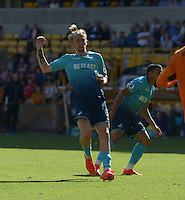 Pictured: Saturday 30 July 2016<br /> Re: Wolverhampton Wanderers v Swansea City FC, pre-season friendly at the Molineux Stadium, England, UK<br /> Swan's Oliver McBurnie celbrates his goal