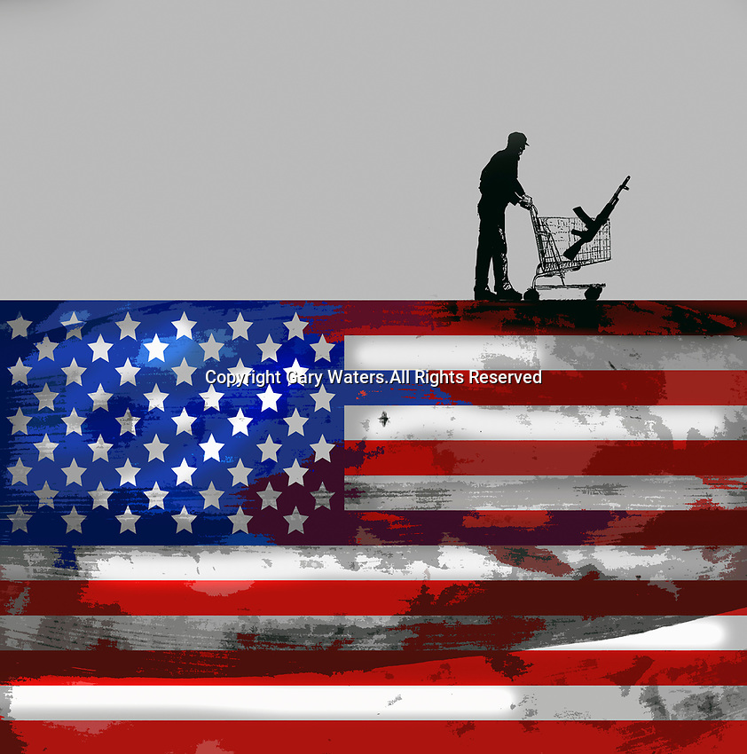 Man with machine gun in shopping trolley on top of United States flag
