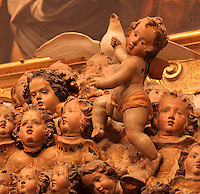 Detail of sculpted cherubs with dove of peace behind, in the the Jesuit Church of Saints Justus and Pastor of Alcala, built 1575 on the site of a mosque in Granada, Andalusia, Southern Spain. Saints Justus and Pastor were 4th century schoolboy christian martyrs, who were killed for their faith under the persecution of the christians by the Roman emperor Diocletian. Granada was listed as a UNESCO World Heritage Site in 1984. Picture by Manuel Cohen