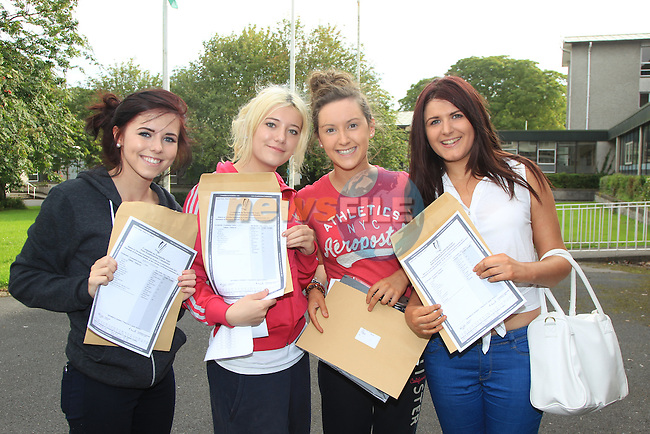 Kirstie Lenahan, Megan Clarke, Gemma Sourin and Sarah Walker after collecting there leaving cert results..Picture: Fran Caffrey / www.newsfile.ie