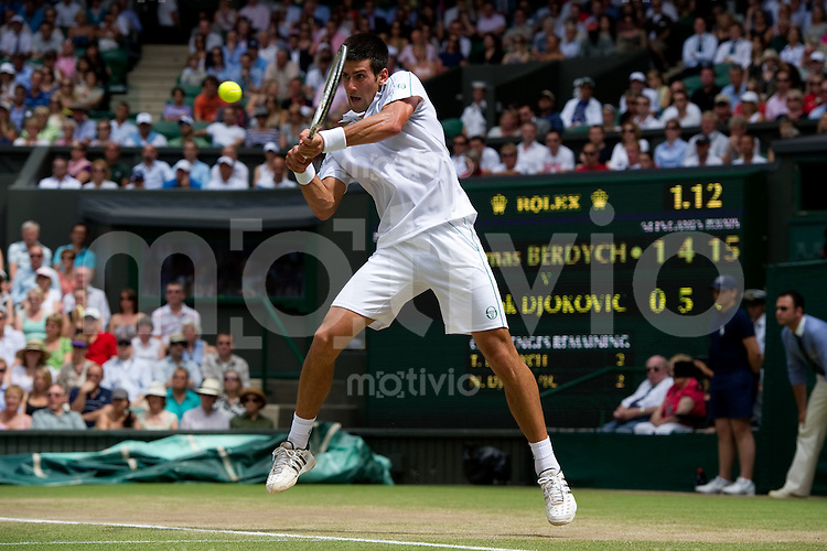 Novak Djokovic (SRB) plays against Tomas Berdych (CZE) on Centre Court. The Wimbledon Championships 2010 The All England Lawn Tennis & Croquet Club  Day 11 Friday 02/07/2010