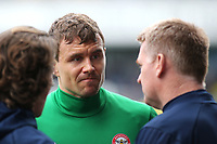 Andreas Bjelland of Brentford informs his manager, Dean Smith, that he has suffered an injury in the pre-match warm up during Millwall vs Brentford, Sky Bet EFL Championship Football at The Den on 10th March 2018