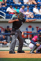 Umpire J.J. January makes a call during the first game of a double header between the Biloxi Shuckers and Pensacola Blue Wahoos on April 26, 2015 at Pensacola Bayfront Stadium in Pensacola, Florida.  Biloxi defeated Pensacola 2-1.  (Mike Janes/Four Seam Images)