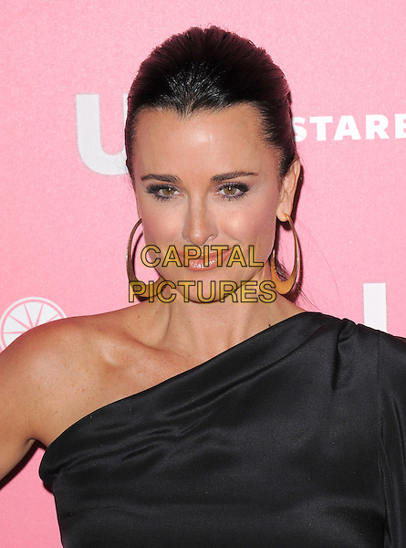 KYLE RICHARDS .at US Weekly Hot Hollywood Style Issue Party held at Eden in Hollywood, California, USA, April 26th 2011..portrait headshot gold hoop earrings beauty hair up  one shoulder black sleeve.CAP/RKE/DVS.©DVS/RockinExposures/Capital Pictures.