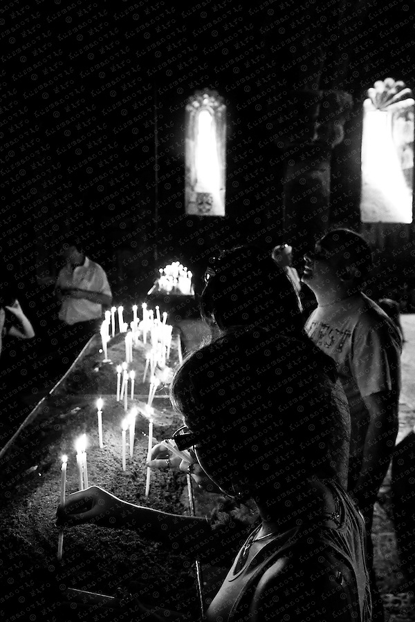 People light candels in the monastery of Geghard a unique architectural construction in the Kotayk province of Armenia, being partially carved out of the adjacent mountain, surrounded by cliffs. The name commonly used for the monastery today, Geghard, or more fully Geghardavank originates from the spear which had wounded Jesus at the Crucifixion, allegedly brought to Armenia by Apostle Jude, called here Thaddeus, and stored amongst many other relics. Now it is displayed in the Echmiadzin treasury.