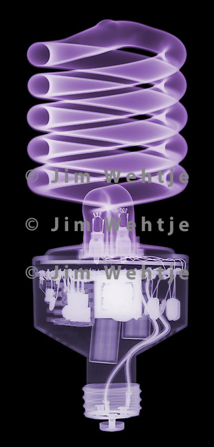 X-ray image of a compact fluorescent bulb (purple on black) by Jim Wehtje, specialist in x-ray art and design images.