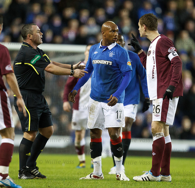 Ref Brian Winter separates El Hadji Diouf and Marius Zaliukas