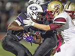 Cedar Ridge's Ian Peterson on fights for yardage on the punt return against Rouse Friday at Dragon Stadium.  (LOURDES M SHOAF for Round Rock Leader.)