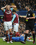 Jack Collins of West Ham fouls Eden Hazard of Chelsea in action during the Barclays Premiere League match between Chelsea and West Ham United at Stamford Bridge on Sunday March 17, 2013 in London, England Picture Zed Jameson/pixel 8000 ltd.