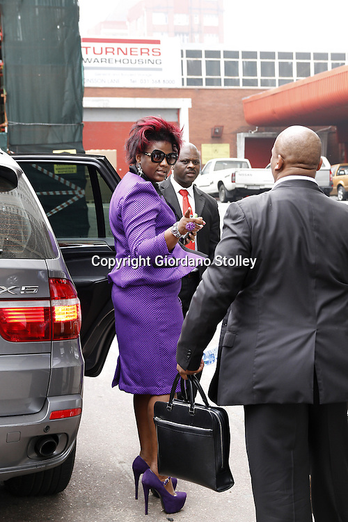 DURBAN - 19 September 2013 Durban businesswoman Shauwn Mpisane speaks to her husband Sibusiso (right) after leaving the Durban Commercial Crimes Court as a body guard (centre) looks on after the State's bid to obtain a six week postponement was refused. Mpisane faces 53 charges of fraud, forgery and uttering of a forged document. Mpisane is accused of submitting forged documents to obtain Construction Industry Development Board (CIDB) gradings, which were then used to win five public works department tenders worth R140 million. Picture: Allied Picture Press/APP