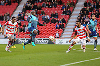 Adebayo Akinfenwa of Wycombe Wanderers (centre) during the Sky Bet League 2 match between Doncaster Rovers and Wycombe Wanderers at the Keepmoat Stadium, Doncaster, England on 29 October 2016. Photo by David Horn.