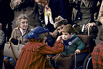 Princess Diana, talking to boy in wheelchair.<br />