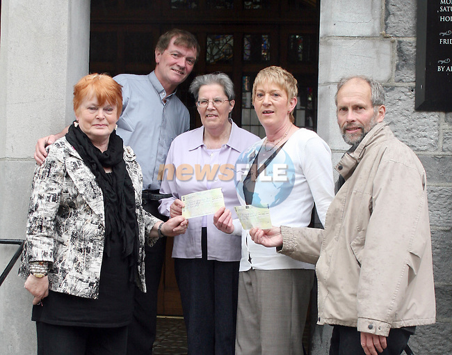 Phil Cunningham and Fr. Iggy O'Donovan present cheques to Sr. Agnes and Geraldine Clarke of Drogheda Youth Development and to Ron Barrow of Asra Hawariat School Trust Fund, Ethiopia...Photo NEWSFILE/Jenny Matthews.(Photo credit should read Jenny Matthews/NEWSFILE)....This Picture has been sent you under the condtions enclosed by:.Newsfile Ltd..The Studio,.Millmount Abbey,.Drogheda,.Co Meath..Ireland..Tel: +353(0)41-9871240.Fax: +353(0)41-9871260.GSM: +353(0)86-2500958.email: pictures@newsfile.ie.www.newsfile.ie.FTP: 193.120.102.198.