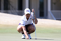 WALLACE, NC - MARCH 09: Tonrak Tasaso of High Point University lines up a putt on the 15th green of the River Course at River Landing Country Club on March 09, 2020 in Wallace, North Carolina.