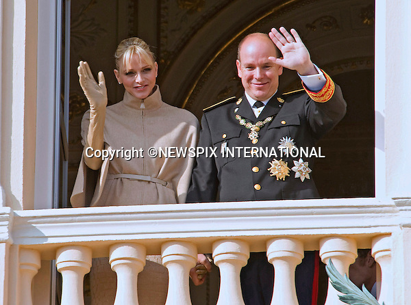 "PRINCESS CHARLENE.looked rather happy with husband Prince Albert paying close attention..Is ther an imminent announcement for the couple who married in July, probably a heir to the Monagasque dynasty. Time will tell..The couple were attending the National Day Fsetivities with other members of the Monaco Royal Family in Monte Carlo, Monaco_19/11/2011.Mandatory Credit Photos: ©Francis Dias/NEWSPIX INTERNATIONAL..**ALL FEES PAYABLE TO: ""NEWSPIX INTERNATIONAL""**..PHOTO CREDIT MANDATORY!!: NEWSPIX INTERNATIONAL(Failure to credit will incur a surcharge of 100% of reproduction fees)..IMMEDIATE CONFIRMATION OF USAGE REQUIRED:.Newspix International, 31 Chinnery Hill, Bishop's Stortford, ENGLAND CM23 3PS.Tel:+441279 324672  ; Fax: +441279656877.Mobile:  0777568 1153.e-mail: info@newspixinternational.co.uk"