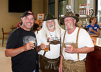 Wisconsin Brewing Company president, Carl Nolen, toasts the creation of Depth Charge Scotch Ale by brewmasters Kirby Nelson and Mike McGuire (L-R) on Sunday, July 12, 2015, in Verona, Wisconsin.