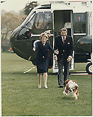 United States President Ronald Reagan and First Lady Nancy Reagan are greeted by their dog &quot;Rex&quot; after arriving at the White House aboard Marine-1 on April 20, 1986.<br /> Credit: White House via CNP