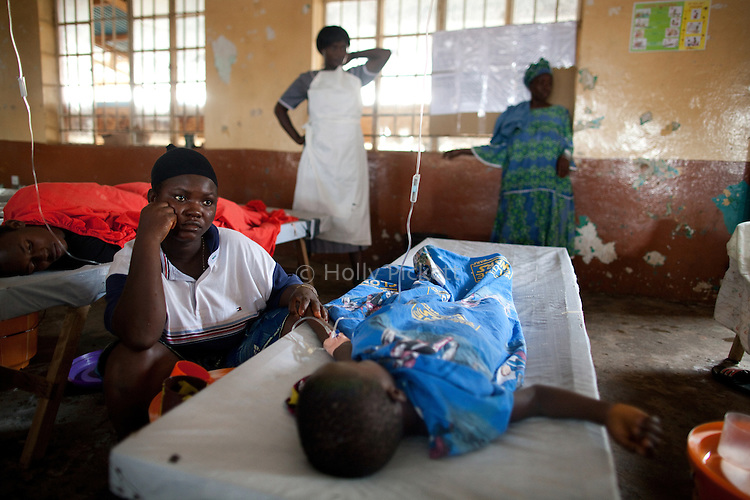 Sia Yabom Bangura sits at the bed of her 5-year-old son Aliou Kamara at Wellington Cholera Treatment Center, Freetown, Sierra Leone, Aug. 14, 2012. Médecins Sans Frontières Belgium, in collaboration with the Sierra Leone Ministry of Health, is running four emergency cholera treatment centers to keep up with the number of patients. Many of the roughly 120 daily patients seen by the MSF team come from extremely impoverished areas of the densely-populated capital, where proper systems for drainage and waste disposal are almost non-existent. Outbreaks of water-borne diseases like cholera become even more likely during the rainy season, which is expected to last at least two more months.