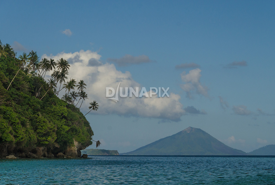 A view of Gunung Api from the palm-studded back side of Run Island in the Banda Archipelago.