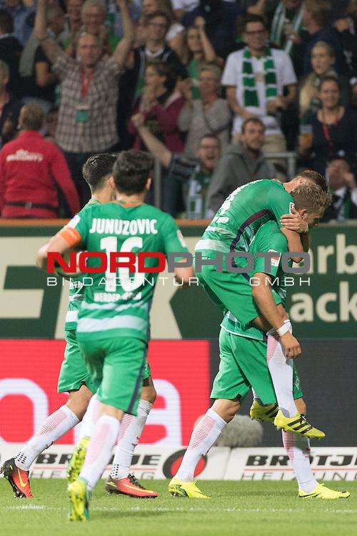 24.09.2016, Weser Stadion, Bremen, GER, 1.FBL, Werder Bremen vs VFL Wolfsburg, im Bild<br /> <br /> Jubel Bremen nach dem 1 zu 1<br /> Lennart Thy (Bremen #11)<br /> Robert Bauer (Bremen #4)<br /> Zlatko Junuzovic (Bremen #16)<br /> <br /> Foto &copy; nordphoto / Kokenge